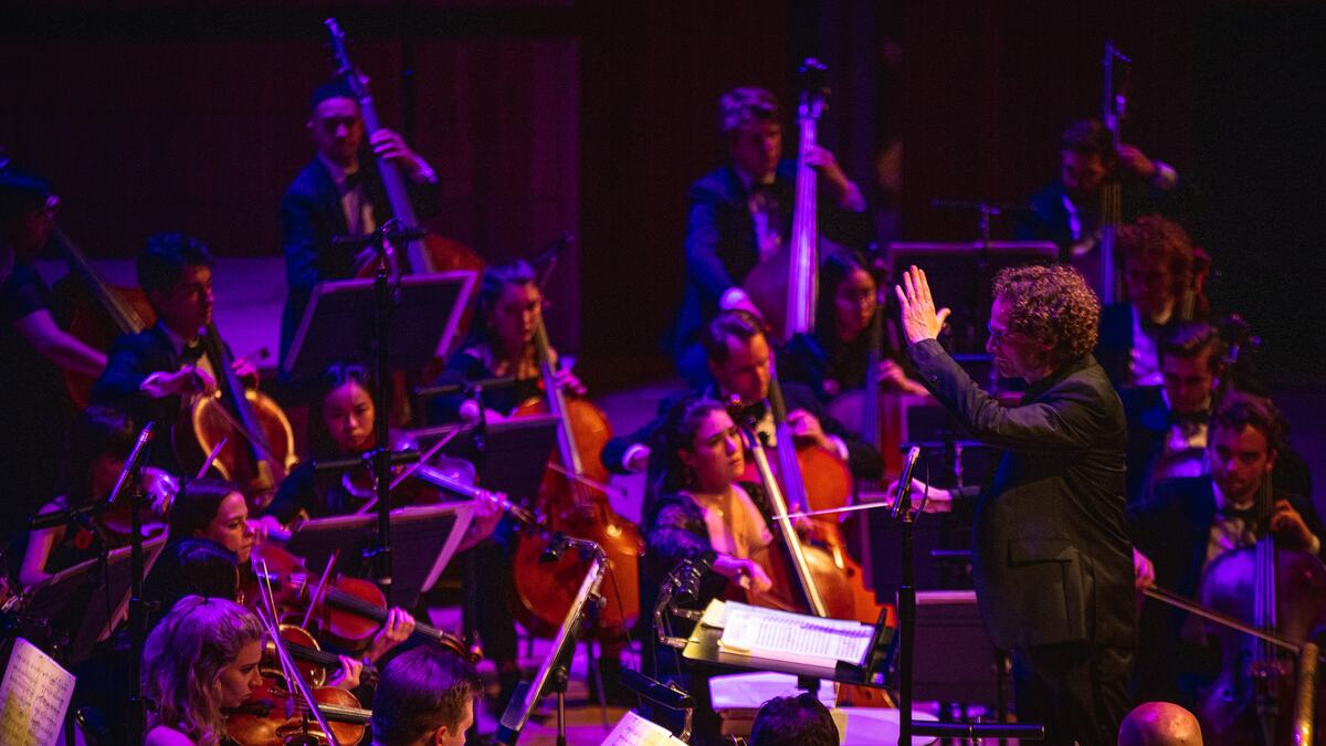 Orion Orchestra performing under and around purple light. This image will promote NUTS concert on 25 Nov 2021 RFH.